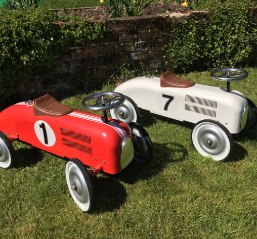 Pair of metal racing cars for toddlers to hire Southampton parties